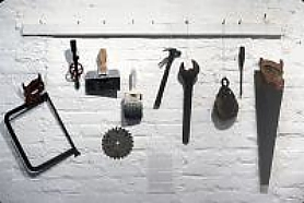 Architects' & builders' tools--saw, drill, paint brush, hammer, wrench, screw driver--used by architects