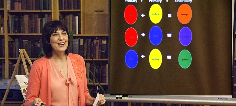 Art teacher Donita Ellison gives a lesson on color in the bi-weekly Education Workshop