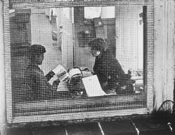 Andre Kertesz photo of Chaim and Dorothy Koppelman seen through Terrain Gallery window