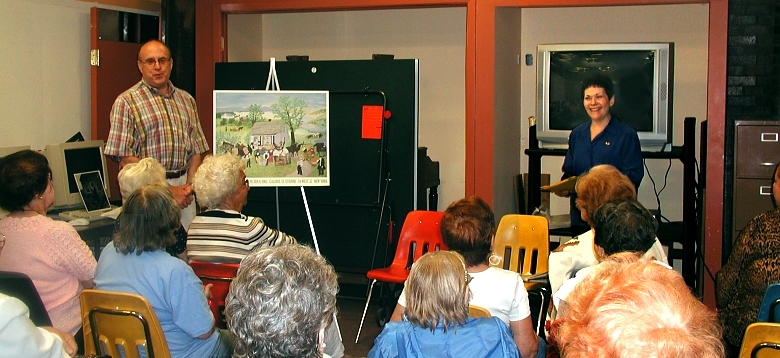 Jeffrey Carduner and Anne Fielding give a talk at a senior center