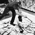 Jackson Pollock in the action of painting